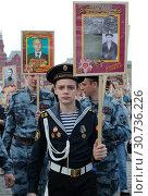 """Купить «Москва, молодой кадет на марше """"Бессмертный полк""""», эксклюзивное фото № 30736226, снято 9 мая 2019 г. (c) Дмитрий Неумоин / Фотобанк Лори"""