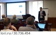 Купить «Audience listens to the lecturer at the conference», видеоролик № 30736454, снято 20 января 2020 г. (c) Антон Гвоздиков / Фотобанк Лори