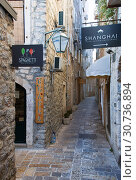 Narrow street in Budva in morning. Budva among oldest urban settlements of Adriatic coast, UNESCO World Heritage Site (2015 год). Редакционное фото, фотограф Papoyan Irina / Фотобанк Лори