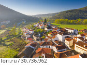Купить «Aerial view of small town with red roofs during sunrise time. Top View of Valhelhas village in central Portugal», фото № 30736962, снято 27 апреля 2019 г. (c) Кирилл Трифонов / Фотобанк Лори
