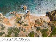 Купить «Aerial view of a sandy beach line full of bathers and colorful umbrellas on Do Camilo beach in Lacos, Algarve, Portugal», фото № 30736966, снято 29 апреля 2019 г. (c) Кирилл Трифонов / Фотобанк Лори