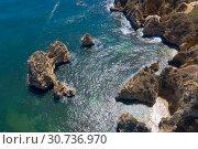 Купить «Atlantic ocean sandy beach with turquoise ocean and waves. Aerial view of Do Camilo beach in Lacos, Algarve, Portugal», фото № 30736970, снято 29 апреля 2019 г. (c) Кирилл Трифонов / Фотобанк Лори