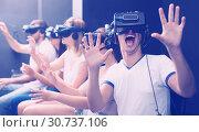 Купить «Excited man experiencing with friends virtual reality», фото № 30737106, снято 6 июля 2017 г. (c) Яков Филимонов / Фотобанк Лори