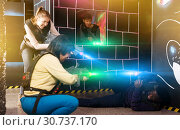 Купить «group of adult people with laser guns having fun», фото № 30737170, снято 23 января 2019 г. (c) Яков Филимонов / Фотобанк Лори