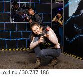 Купить «Emotional girl with laser pistol playing laser tag with multinational team», фото № 30737186, снято 23 января 2019 г. (c) Яков Филимонов / Фотобанк Лори
