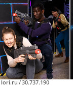 Купить «Two fine laser tag players during lasertag game», фото № 30737190, снято 23 января 2019 г. (c) Яков Филимонов / Фотобанк Лори