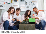 Купить «Young adults in escape room stylized as underground shelter», фото № 30737218, снято 8 октября 2018 г. (c) Яков Филимонов / Фотобанк Лори