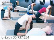 Females exercising during yoga class. Стоковое фото, фотограф Яков Филимонов / Фотобанк Лори