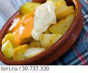Купить «Patatas bravas with garlic mayonnaise and sauce», фото № 30737330, снято 17 июля 2019 г. (c) Яков Филимонов / Фотобанк Лори
