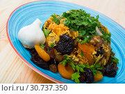 Купить «Pilau with lamb, dried plums and apricots», фото № 30737350, снято 16 августа 2018 г. (c) Яков Филимонов / Фотобанк Лори