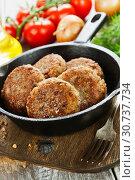 Купить «Buckwheat  burgers on the pan», фото № 30737734, снято 11 мая 2019 г. (c) Надежда Мишкова / Фотобанк Лори
