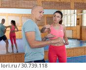 Купить «Self-defense workout with personal trainer in gym, martial art», фото № 30739118, снято 10 апреля 2019 г. (c) Яков Филимонов / Фотобанк Лори