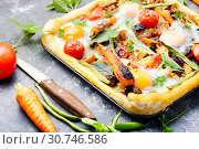 Купить «Hot pizza with with meat and vegetables on slate background», фото № 30746586, снято 7 июля 2018 г. (c) easy Fotostock / Фотобанк Лори