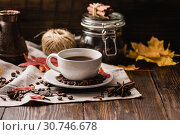Купить «Autumn Leaves with Cup of Coffee. Ingredients, Spices and Some Kitchenware on dark wooden surface.», фото № 30746678, снято 1 октября 2016 г. (c) easy Fotostock / Фотобанк Лори