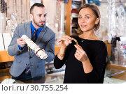 Купить «Portrait of woman customer trying bracelet», фото № 30755254, снято 16 октября 2017 г. (c) Яков Филимонов / Фотобанк Лори