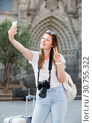 Купить «Enthusiastic female tourist making selfie», фото № 30755322, снято 17 мая 2017 г. (c) Яков Филимонов / Фотобанк Лори
