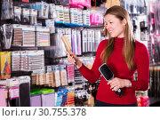 Купить «Female choosing hair combs in store», фото № 30755378, снято 22 марта 2018 г. (c) Яков Филимонов / Фотобанк Лори