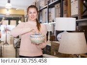 Купить «Positive woman buyer holding wicker basket», фото № 30755458, снято 15 ноября 2017 г. (c) Яков Филимонов / Фотобанк Лори