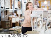 Купить «Positive woman customer standing with bedside», фото № 30755470, снято 15 ноября 2017 г. (c) Яков Филимонов / Фотобанк Лори