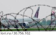Купить «Cargo airplane taxiing after landing», видеоролик № 30756102, снято 4 мая 2019 г. (c) Игорь Жоров / Фотобанк Лори