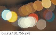Купить «Blur lights of night city. Colorful bokeh», видеоролик № 30756278, снято 24 июля 2019 г. (c) Данил Руденко / Фотобанк Лори