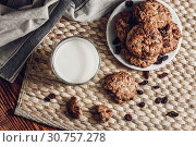 Купить «Glass of Milk and Oatmeal Cookies on White Plate. View from Above.», фото № 30757278, снято 7 ноября 2016 г. (c) easy Fotostock / Фотобанк Лори