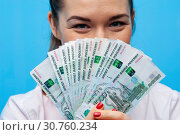 Купить «Close-up portrait of young business woman with money cash fan», фото № 30760234, снято 12 марта 2019 г. (c) Pavel Biryukov / Фотобанк Лори