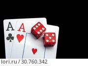 Купить «Close-up - Two aces, playing cards and red gaming dices on black table.», фото № 30760342, снято 16 июля 2020 г. (c) Pavel Biryukov / Фотобанк Лори