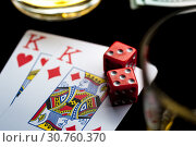 Купить «Playing Cards, Red Gaming Dices And Glasses of Whiskey», фото № 30760370, снято 19 мая 2019 г. (c) Pavel Biryukov / Фотобанк Лори