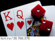 Купить «Close-up - Playing Cards And Red Gaming Dices», фото № 30760378, снято 20 мая 2019 г. (c) Pavel Biryukov / Фотобанк Лори
