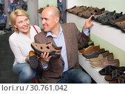 Купить «Woman selecting shoes for man», фото № 30761042, снято 22 мая 2019 г. (c) Яков Филимонов / Фотобанк Лори