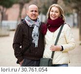 Купить «Couple relaxing during city walk», фото № 30761054, снято 18 июня 2019 г. (c) Яков Филимонов / Фотобанк Лори