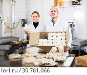 Купить «Different aged couple standing with box of turron in production workshop», фото № 30761066, снято 22 апреля 2017 г. (c) Яков Филимонов / Фотобанк Лори