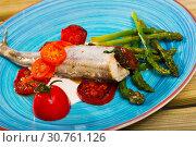 Купить «Baked fish poutassou with dried tomatoes, asparagus and creamy-garlic sauce», фото № 30761126, снято 23 августа 2018 г. (c) Яков Филимонов / Фотобанк Лори