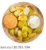Купить «Patatas bravas with garlic mayonnaise and sauce», фото № 30761194, снято 17 июля 2019 г. (c) Яков Филимонов / Фотобанк Лори