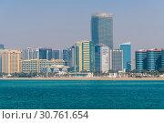 Купить «Abu Dhabi, UAE - March 29. 2019. View of city from the Arabian Gulf», фото № 30761654, снято 29 марта 2019 г. (c) Володина Ольга / Фотобанк Лори