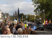 Купить «UK SCOTLAND Edinburgh -- 16 Sep 2010 -- Crowds wave papal flags and those of St Andrew during Pope Benedict XVI's visit to Edinburgh, Scotland. The pope...», фото № 30765618, снято 16 сентября 2010 г. (c) age Fotostock / Фотобанк Лори
