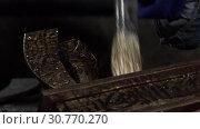 Купить «Close-up Of A Female Decorator Covering An Iron Produc», видеоролик № 30770270, снято 30 мая 2020 г. (c) Pavel Biryukov / Фотобанк Лори