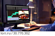 Купить «editor working on video file on computer at night», видеоролик № 30770302, снято 24 января 2020 г. (c) Syda Productions / Фотобанк Лори