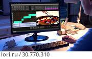 Купить «editor working on video file on computer at night», видеоролик № 30770310, снято 24 января 2020 г. (c) Syda Productions / Фотобанк Лори