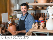 Male artisan in ceramic workshop. Стоковое фото, фотограф Яков Филимонов / Фотобанк Лори