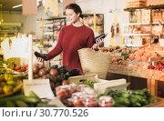 Купить «Customer looking eggplants», фото № 30770526, снято 1 марта 2017 г. (c) Яков Филимонов / Фотобанк Лори