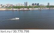 Купить «Traffic along cargo port on Moscow Canal in Moscow, Russia.», видеоролик № 30770798, снято 18 ноября 2019 г. (c) Володина Ольга / Фотобанк Лори