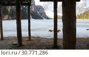 Купить «Young woman hiking on a lago di braies coast with a big backpack», видеоролик № 30771286, снято 19 мая 2019 г. (c) Константин Шишкин / Фотобанк Лори