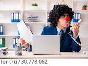 Купить «Young clown businessman working in the office», фото № 30778062, снято 14 декабря 2018 г. (c) Elnur / Фотобанк Лори