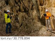 Купить «Geologists against the rocks in the canyon», фото № 30778894, снято 4 мая 2019 г. (c) Евгений Харитонов / Фотобанк Лори