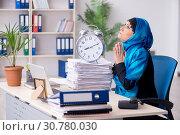 Купить «Female employee in hijab working in the office», фото № 30780030, снято 20 февраля 2019 г. (c) Elnur / Фотобанк Лори