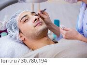 Купить «Young handsome man visiting female doctor cosmetologist», фото № 30780194, снято 16 ноября 2017 г. (c) Elnur / Фотобанк Лори