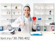 Купить «Young female doctor cardiologist working in the clinic», фото № 30780402, снято 6 декабря 2018 г. (c) Elnur / Фотобанк Лори