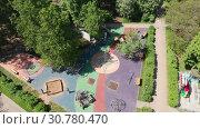 Купить «Rest zone for children in Severnoye Tushino park in Moscow, Russia.», видеоролик № 30780470, снято 6 апреля 2020 г. (c) Володина Ольга / Фотобанк Лори